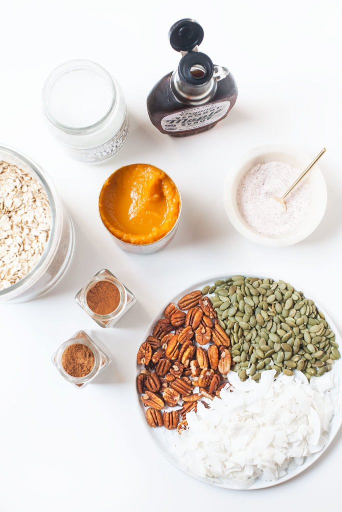 Close-up of low-sugar pumpkin granola ingredients on a white table.