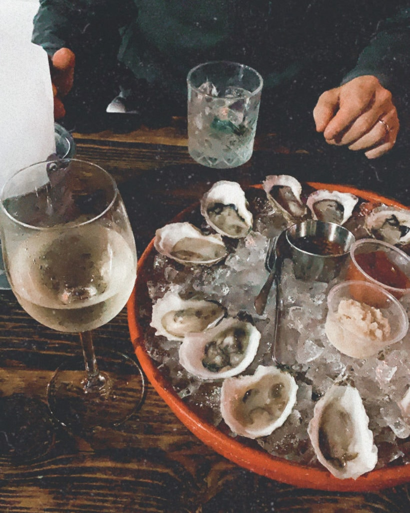 Glass of white wine with oysters.