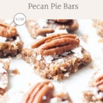 Close-up of pecan pie bars on a white plate.