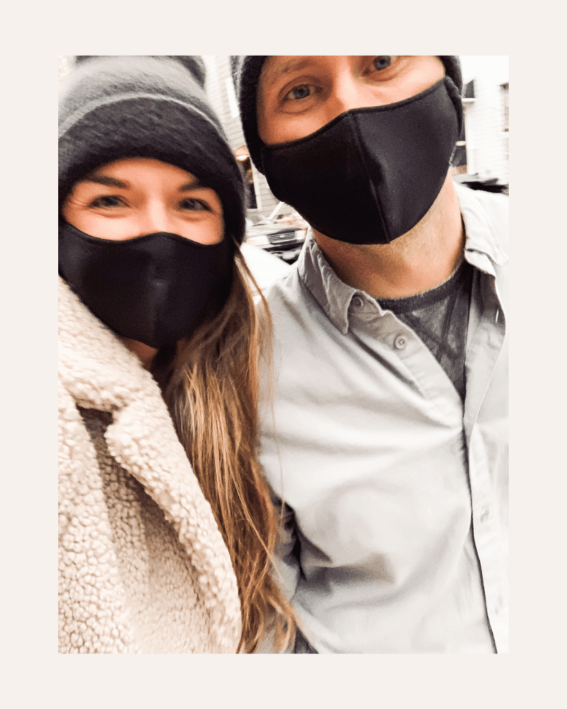 A couple with black face masks on.