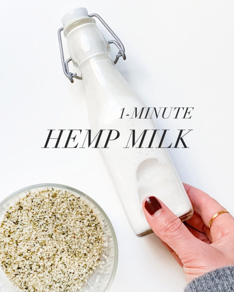 Hand holding a bottle of hemp milk.