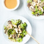 Nutty cauliflower fried rice with broccoli and almond butter sauce.