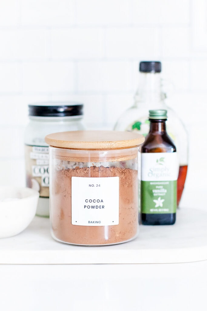Cocoa powder and other ingredients on a countertop.