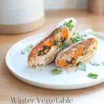 Winter vegetable freezer burritos on a white plate.