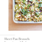 Miso maple sheet pan brussels sprouts and tofu on a counter.