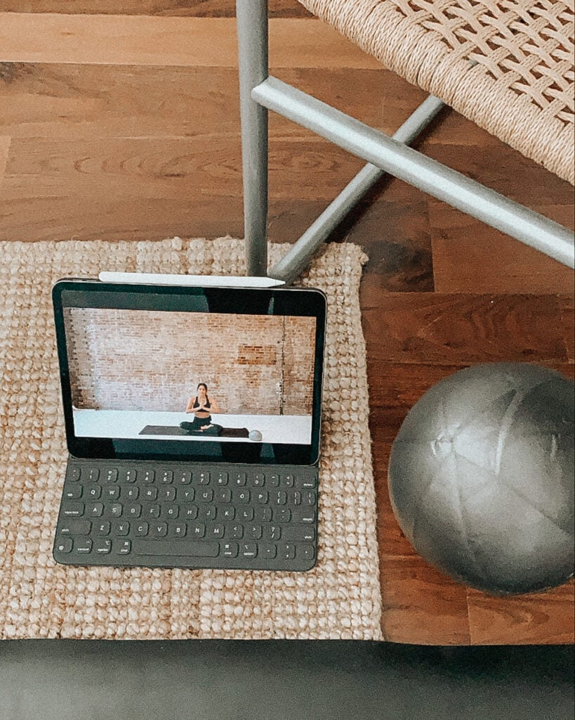 iPad with workout class and pilates ball.