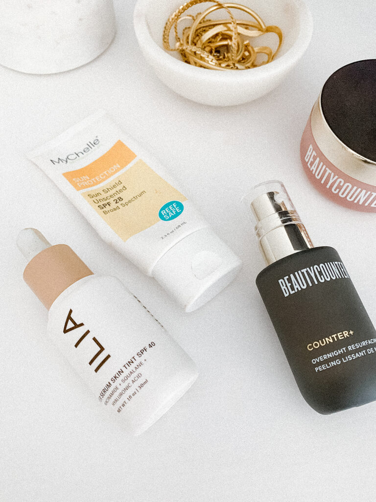 Skincare products on a white surface.