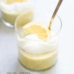 Lemon chia seed pudding in a glass jar with yogurt and a slice of lemon on top.