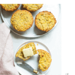 Paleo lemon chia seed muffins with butter and a pink napkin.