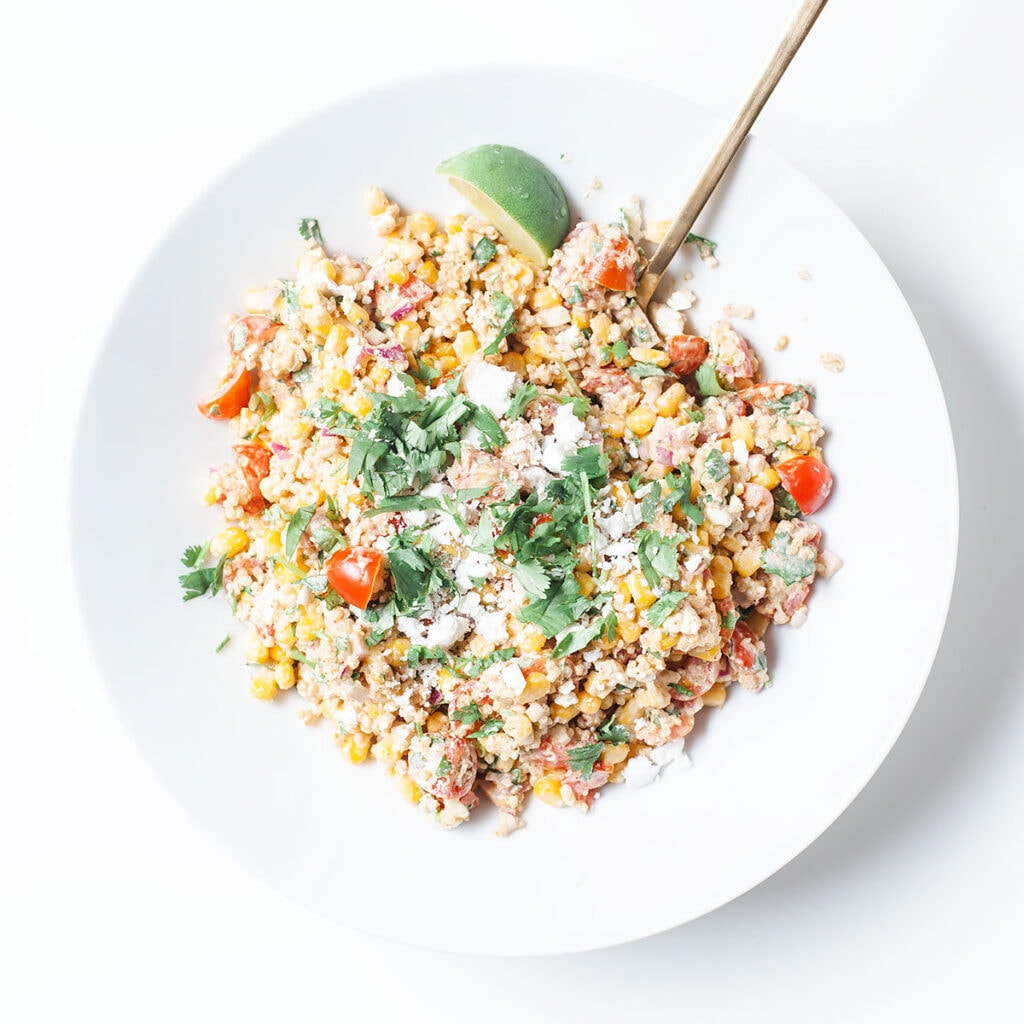 Healthy street corn salad in a white bowl.