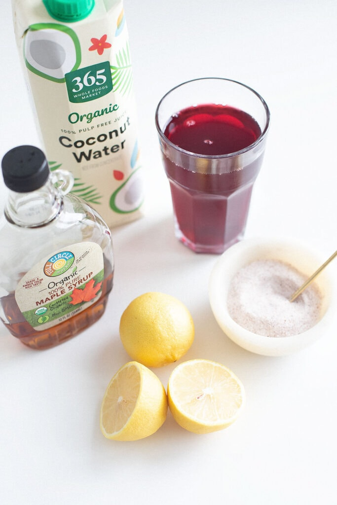 Natural electrolyte sports drink ingredients on a white table.