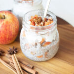 Apple pie chia pudding in glass jars with apples.