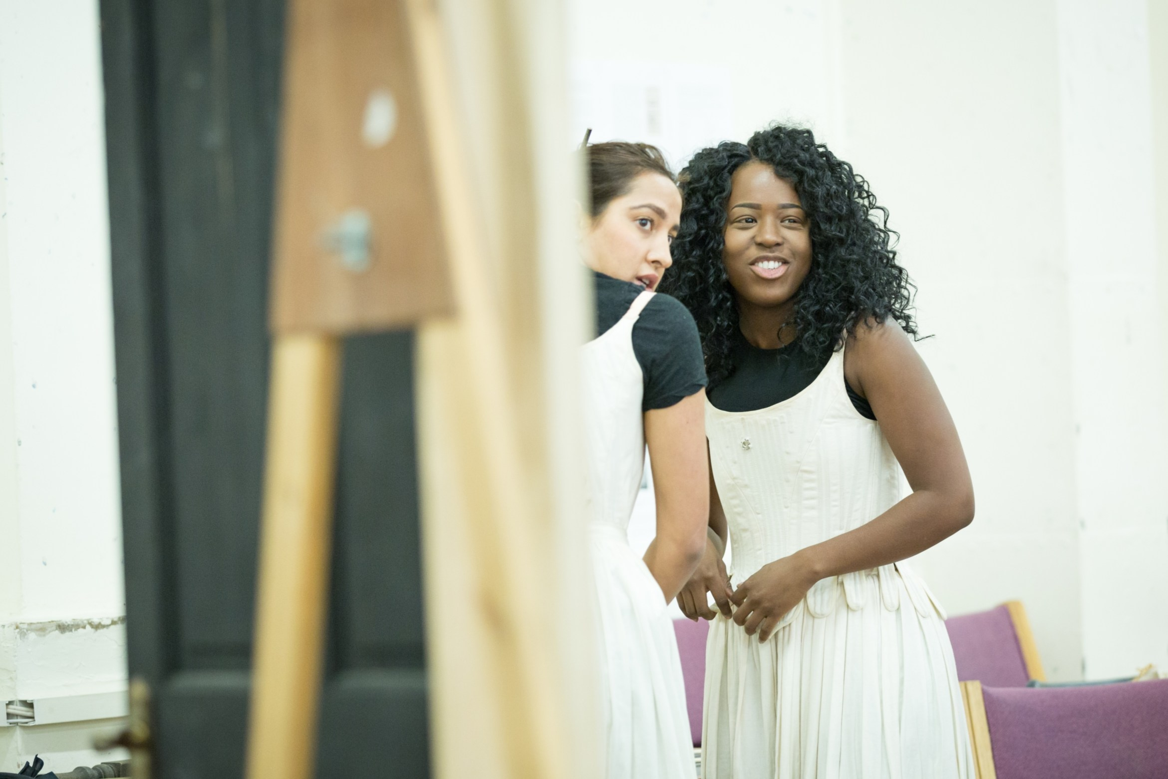 Sheena Bhattessa as Lady Somerset and Gabrielle Brooks as Lady Russell in rehearsals for Queen Anne. Credit Marc Brenner