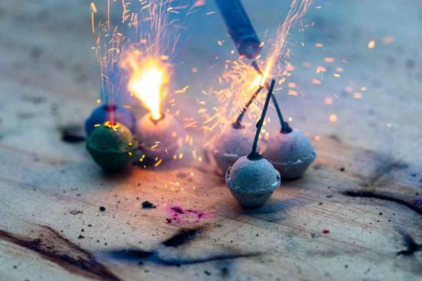 burning bengal bombs on shabby surface
