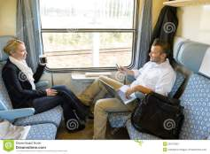 man-woman-sitting-train-talking-28147584