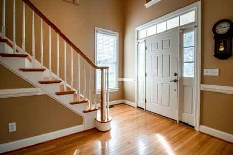 white wooden door with door casing on brown wooden parquet floor