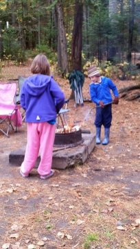 Kids staying warm by the fire
