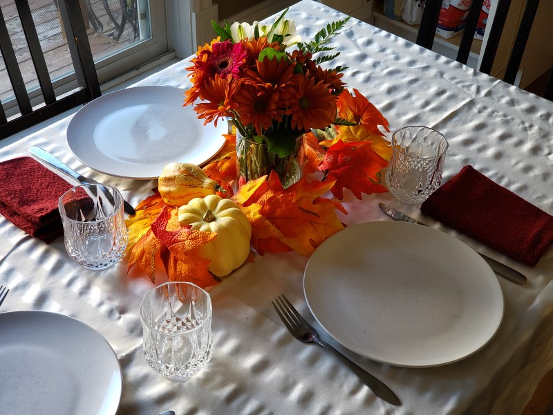 Thanksgiving table setting for three