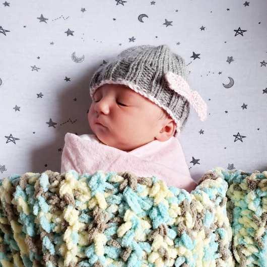 newborn baby sleeping in a cap