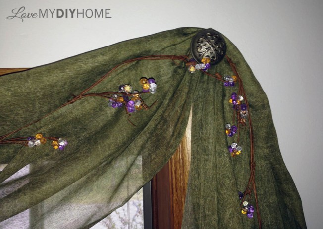 Antique door knob as curtain hanger {Love My DIY Home}