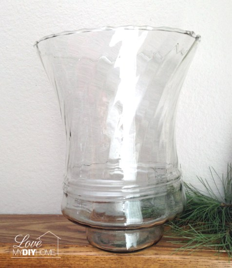 A single large votive paired with a candle stand