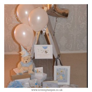 grey bespoke teepee for 1st birthday with balloons and cards