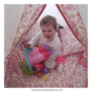 little girl playing inside her pink rose bespoke teepee