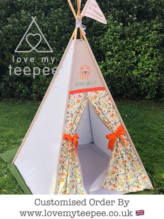 kids baby jungle grey personalised teepee. Lion + name above the doors. Orange bow tiebacks.. Grey polka dot floor mat