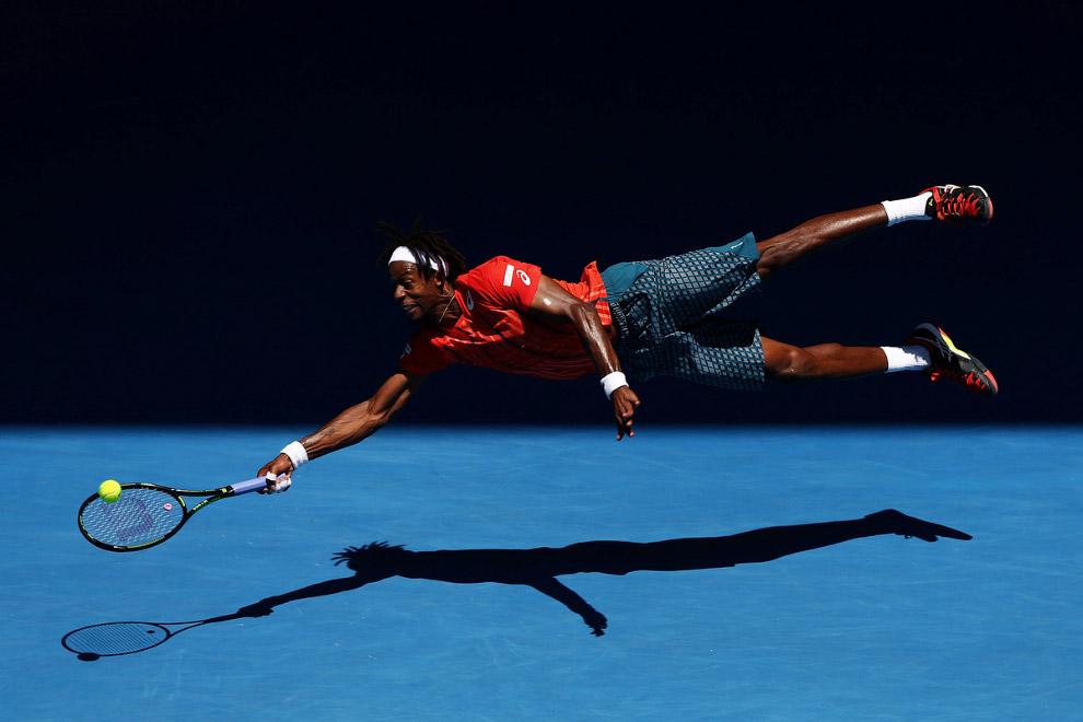 Гаэль Монфис из Франции против Андрея Кузнецова России на Турнире Большого Шлема Australian Open, Австралия