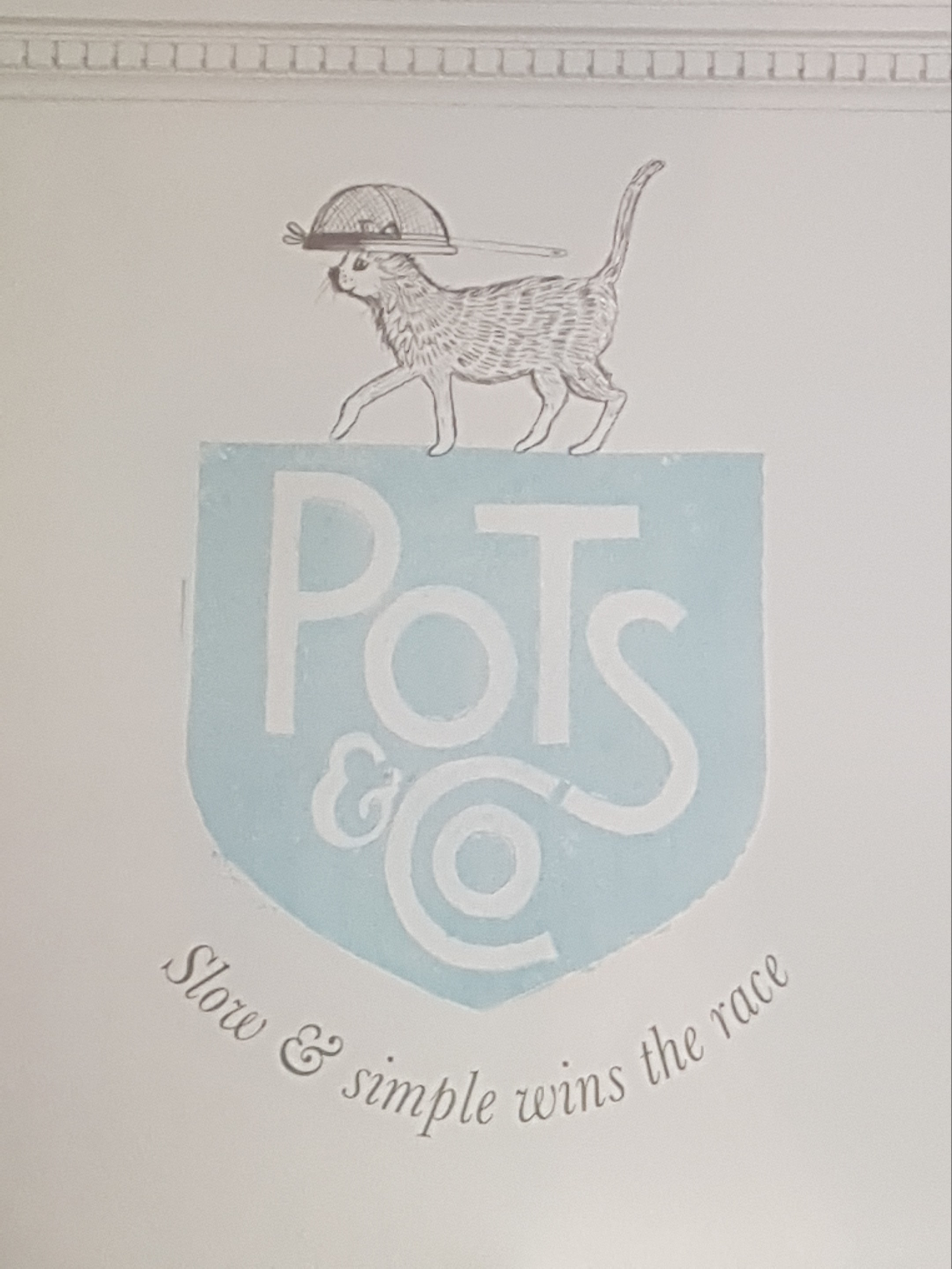 The Pudding Kitchen Pots & Co logo