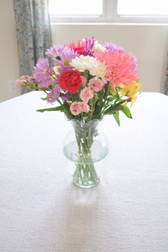 use flowers to stage your house to sell
