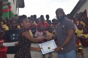 A teacher receiving her certificate