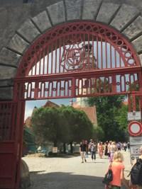 Day Trip Cesky Krumlov Outside castle red gate
