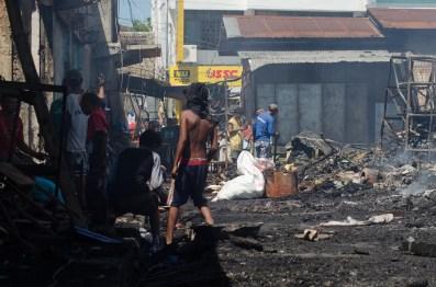 Children sift through the rubble.