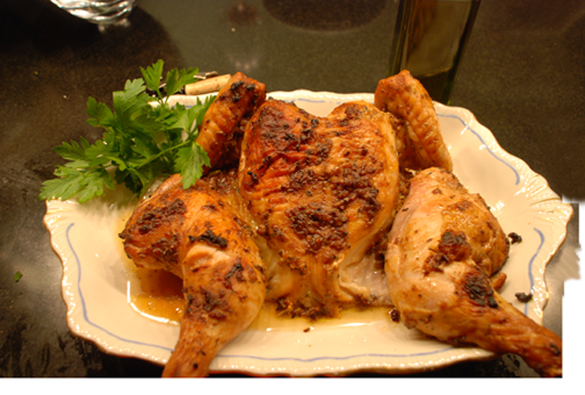 Buttermilk roasted chicken on a white platter.