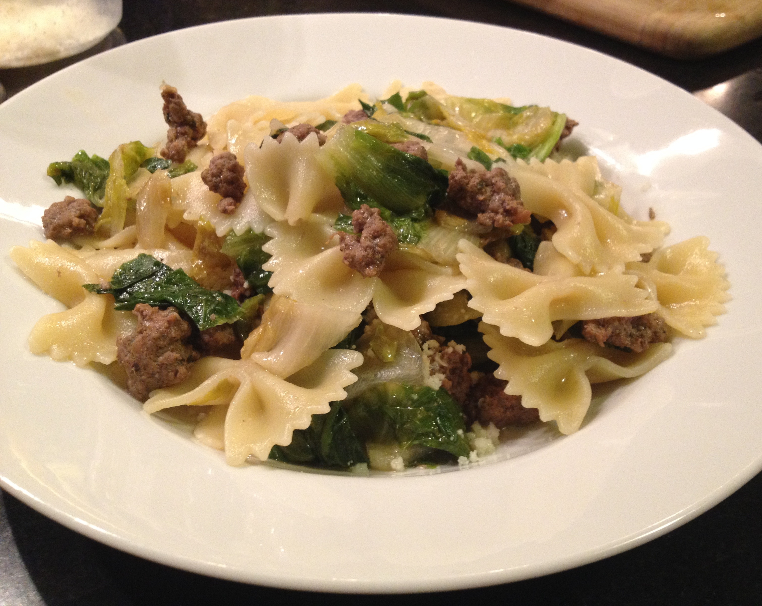 Farfalle with lamb sausage and escarole.