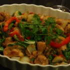 Stir fry chicken thighs with red peppers and cilantro.