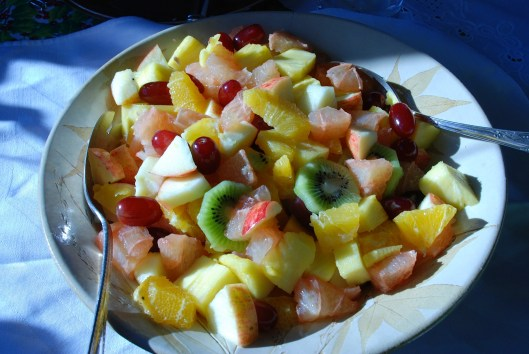 Fruit salad with kiwi, orange, grapes, grapefruit, and pineapple.