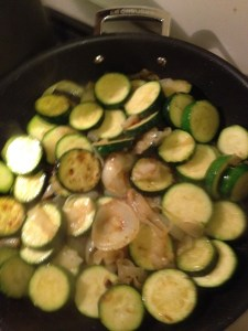 Zucchini and onions in a Le Creuset skillet.