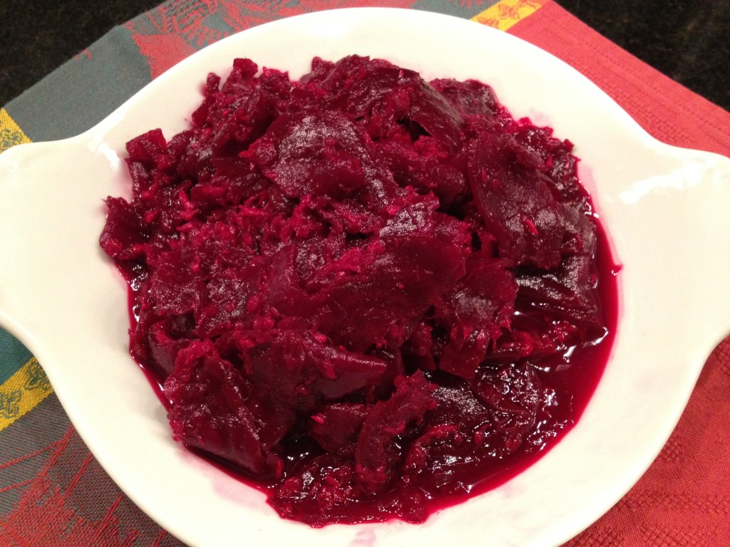 Beets and horseradish on a white plate. Chrzan on a white plate.