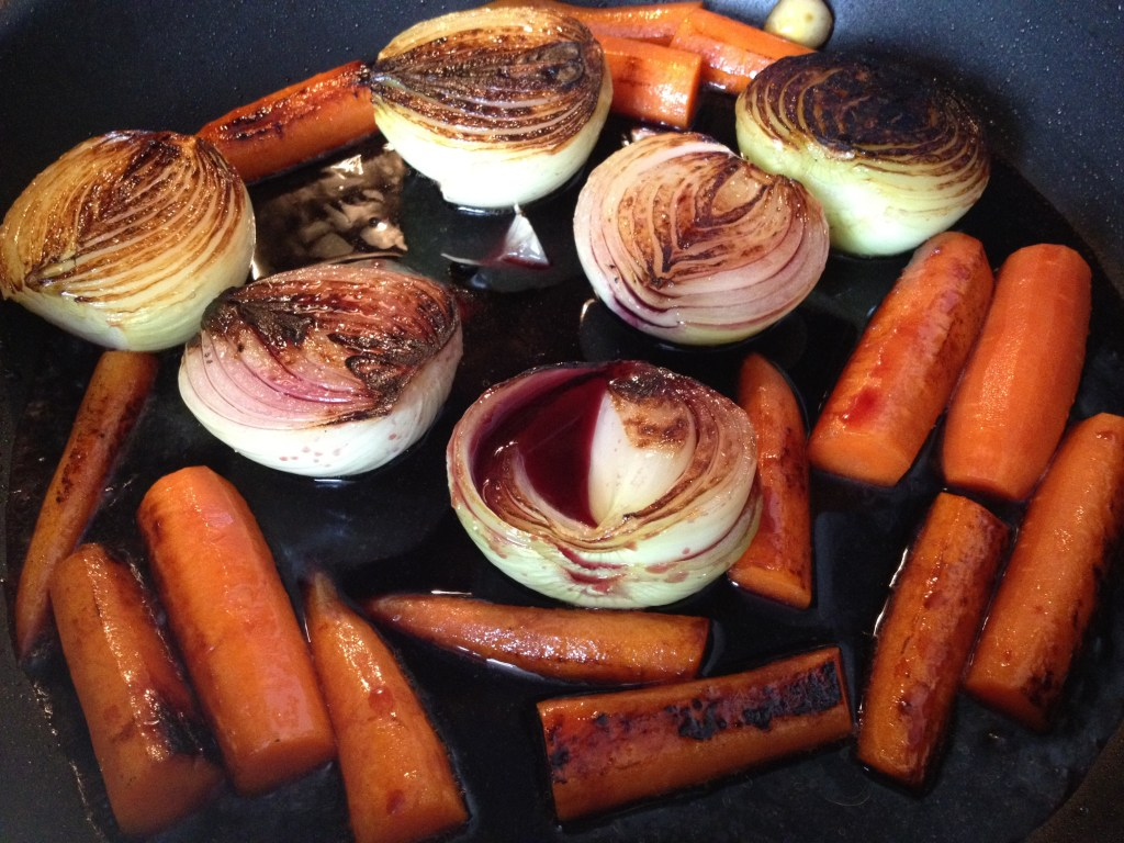 Browned carrots and onions with red wine.