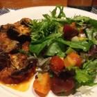 eggplant parmigiano with salad, salad and eggplant parmigiano