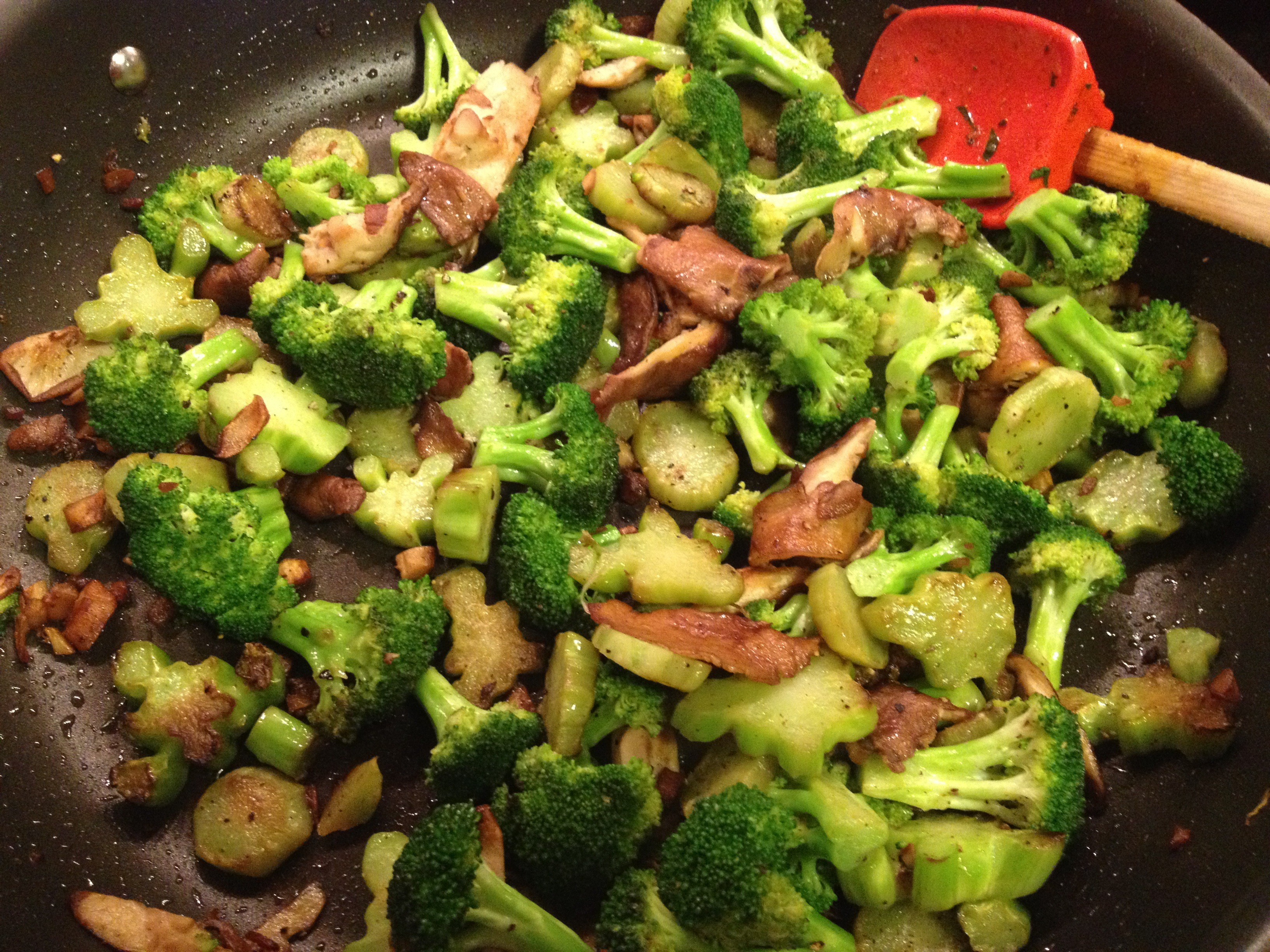 Sauteed Broccoli with shiitake mushrooms in butter and olive oil in a pan.