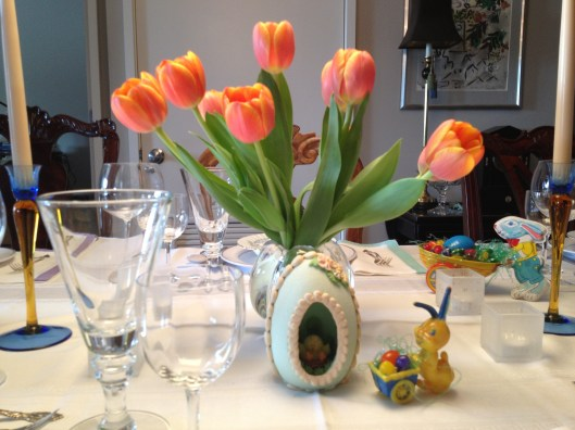 Eadter table set with sugar eggs, tulips and antique Easter toys.