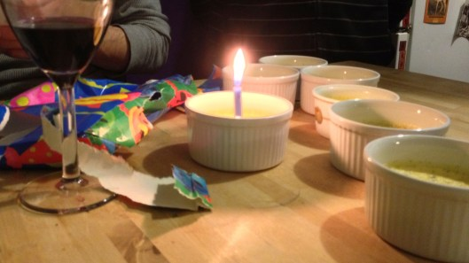 Vanilla pots with a birthday candle.