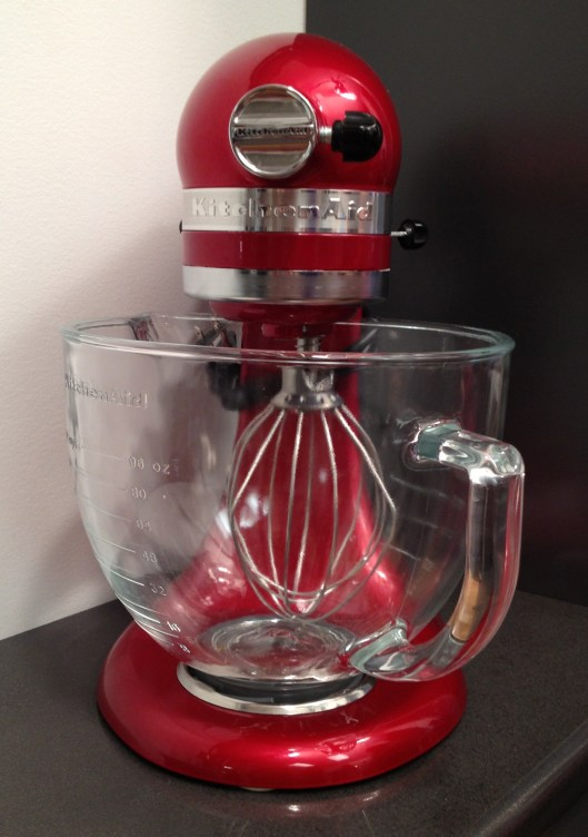 Red Kitchen Aid stand up mixer.