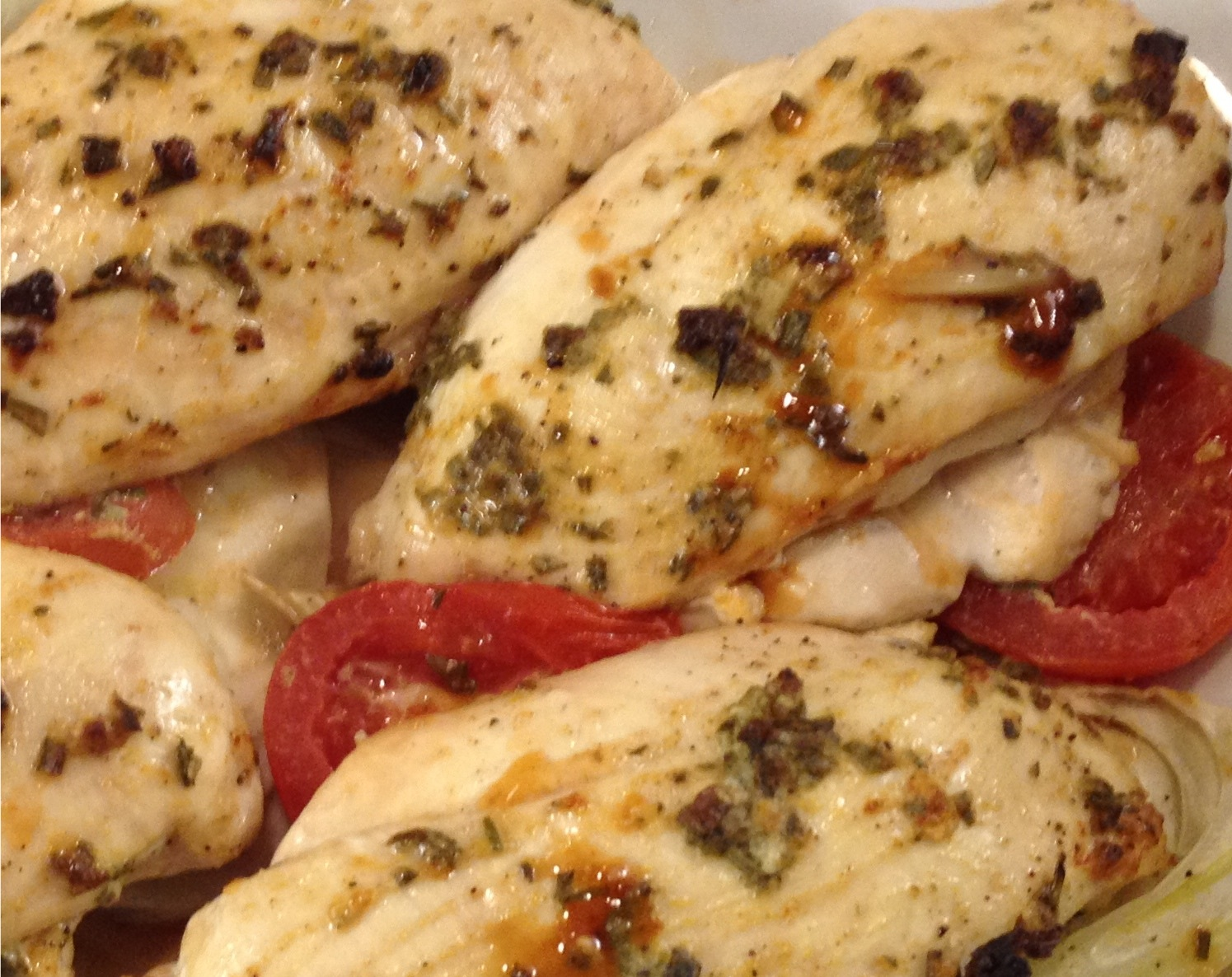 Chicken breasts roasted on tomatoes and fennel.