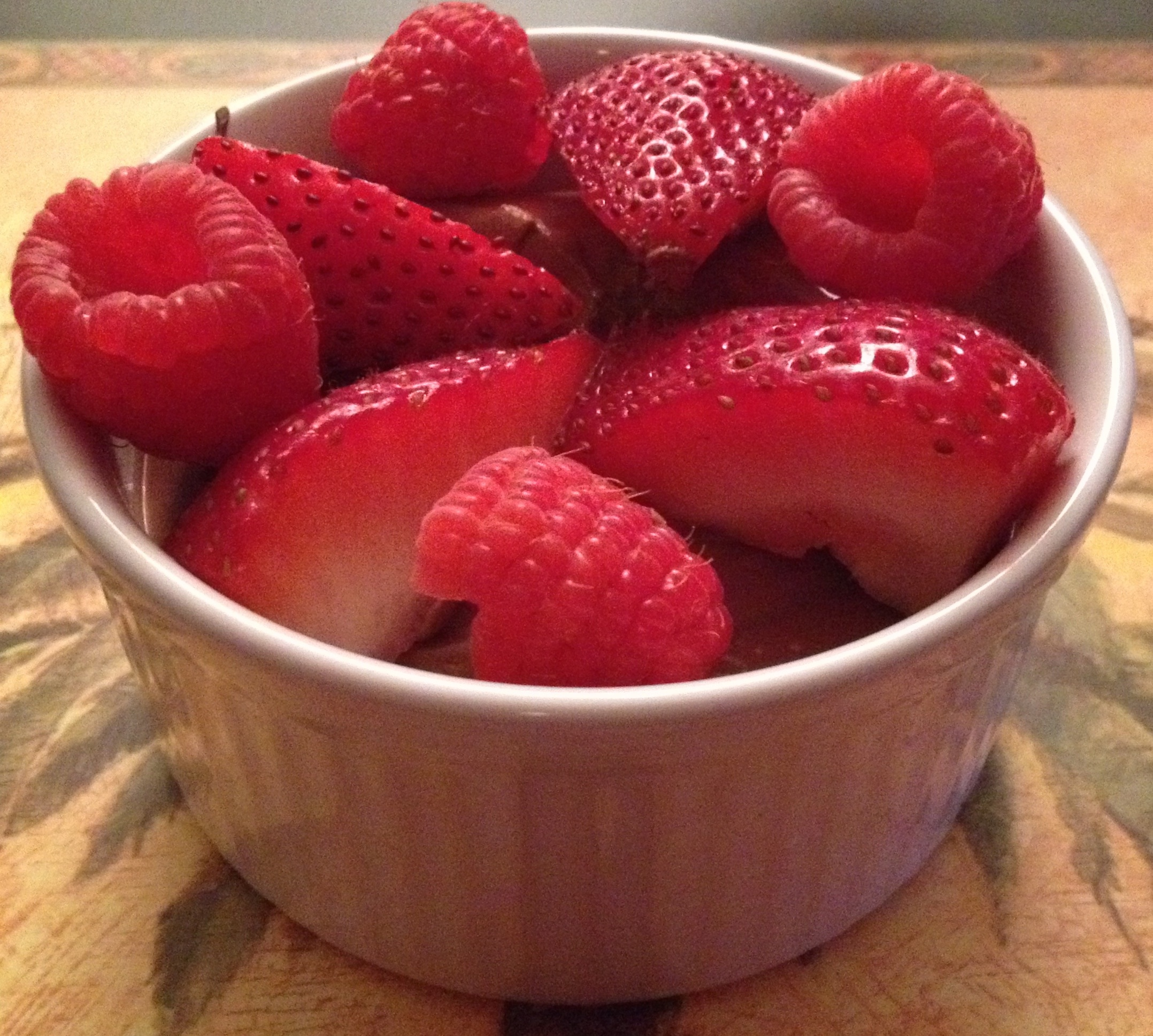 Chocolate mousse garnished with raspberries and strawberries