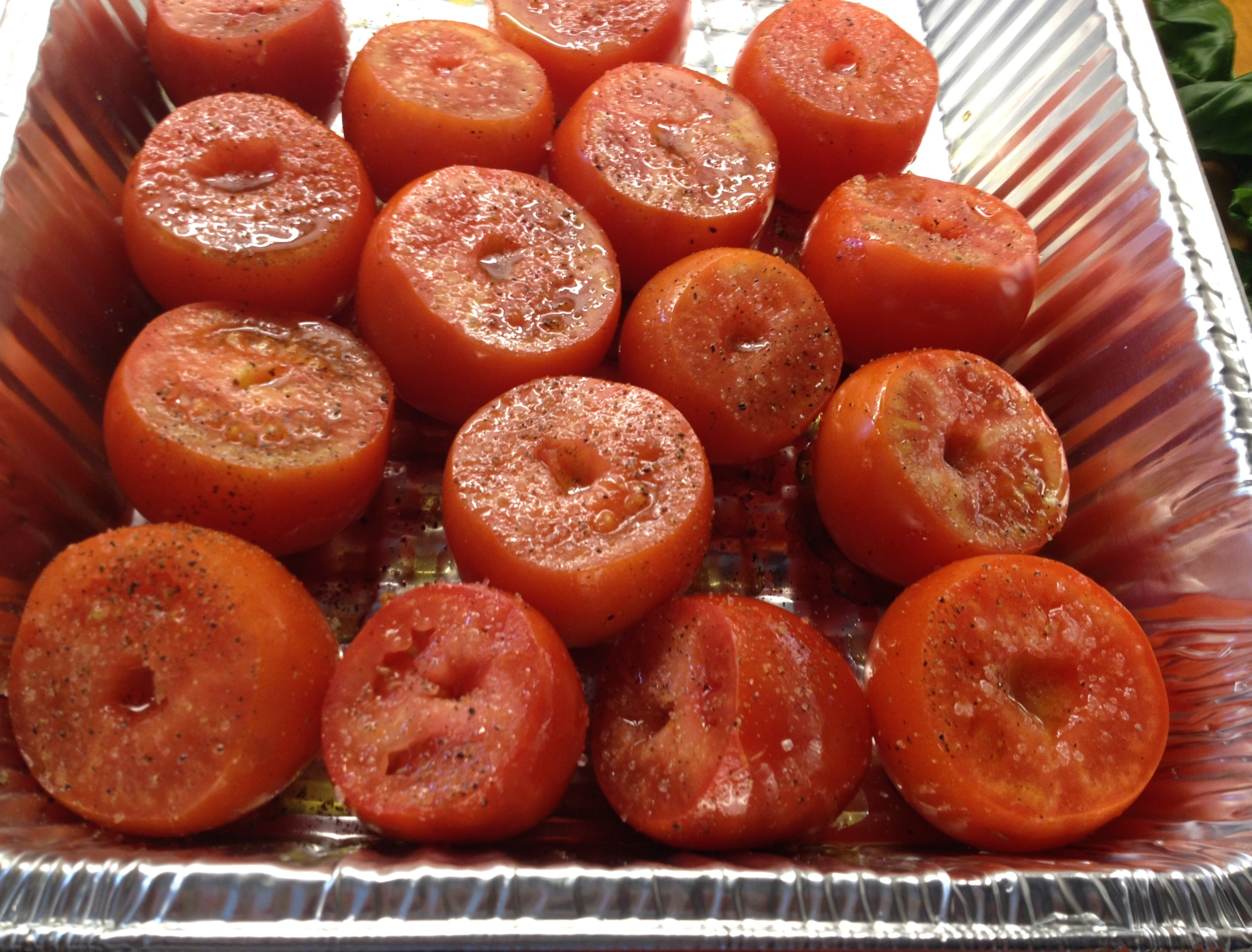 Tomatoes in an aluminum pan.
