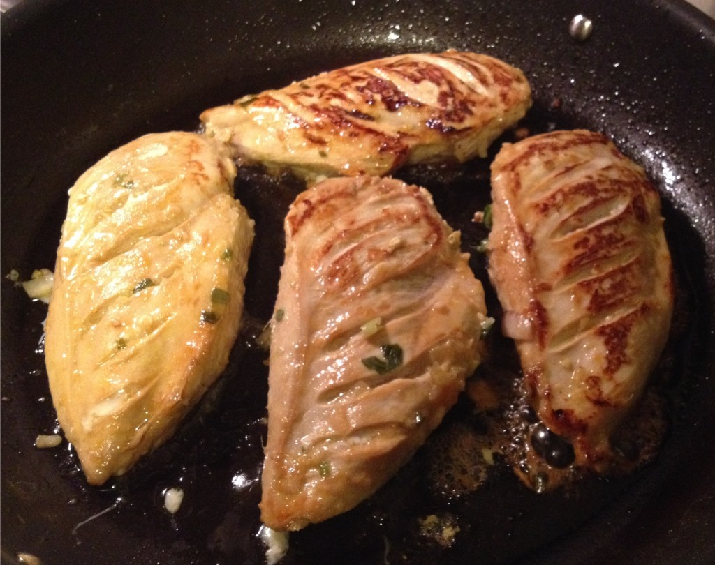Tea and honey marinated chicken breasts browning in the pan